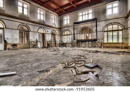 Destroyed dance hall with nice wooden ceiling - stock photo
