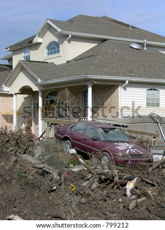 destroyed home and car about 100 ft. from the 17th Street Canal levee breach that flooded New Orleans after Hurricane Katrina - stock photo
