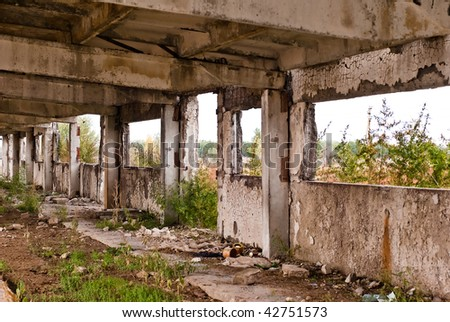 Destroyed interior of an industrial building - stock photo