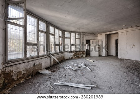 Destroyed interior with barred windows - stock photo