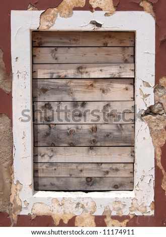 Destroyed part of a home - a window. - stock photo