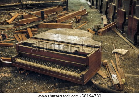 Destroyed piano in an abandoned church.