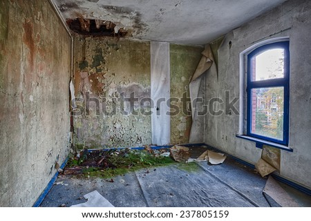Destroyed room inside the building - stock photo
