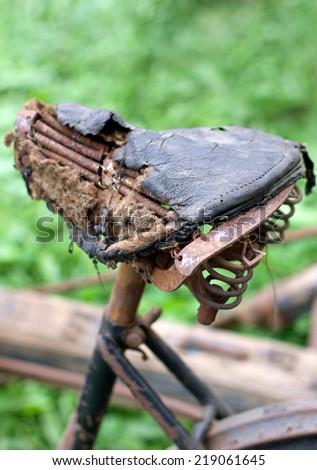 destroyed Rusty bike saddle - stock photo