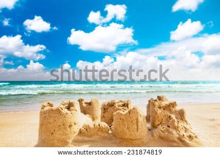 Destroyed sand castle on a beach. Spain - stock photo