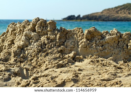 Destroyed sandcastle on the beach - stock photo