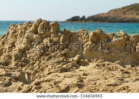 Destroyed sandcastle on the beach
