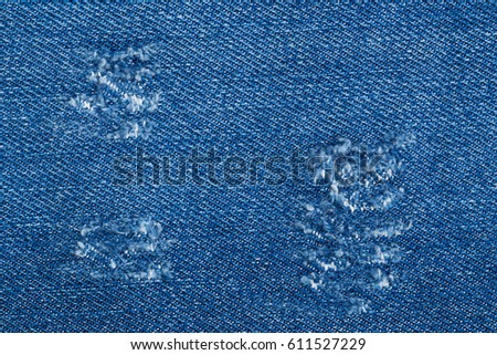 https://thumb7.shutterstock.com/display_pic_with_logo/1769528/611527229/stock-photo-destroyed-torn-blue-denim-background-trace-on-denim-ripped-jeans-texture-611527229.jpg