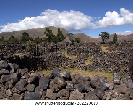 Destroyed walls of the ancient city of Raqchi, Cuzco Region, Canchis Province, San Pedro District, Peru - stock photo