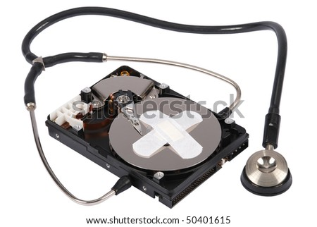 Destroying data from hard disk - conceptual photo. Hard drives and Stethoscope. On white background