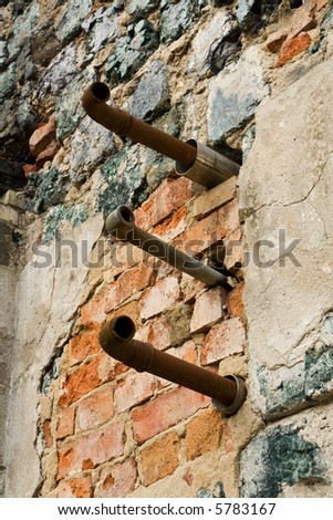 Destruct plumbing sticking out of the wall