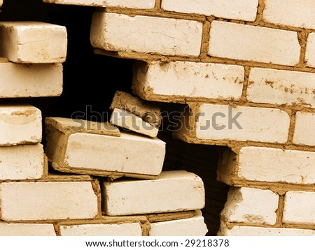 Destruction of a wall of the house from a brick