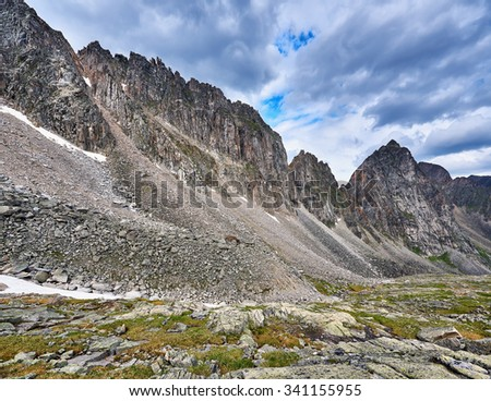 Destruction of ridge under the influence of weathering erosion. Eastern Sayan. Buryatia - stock photo