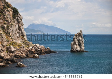 detached cliff in the sea near rocky coast