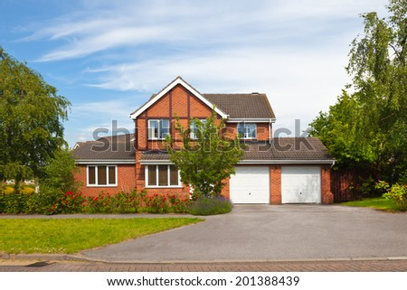 Detached house with garages - stock photo