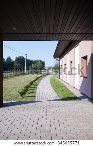 Detached house with garden - view from garage - stock photo