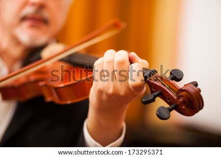 Detail a violinist playing his instrument - stock photo