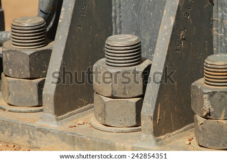 Detail base plate of extra high voltage electric power 500 kV gantry steel structure. - stock photo