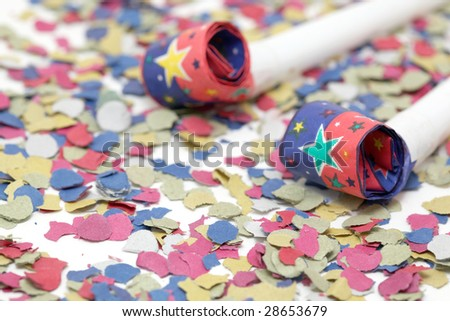 detail blowers on confetti background party and celebration - stock photo
