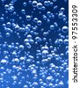 Detail bubbles in blue liquid. - stock photo