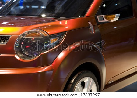 Detail Close Up Of A Red Car - stock photo