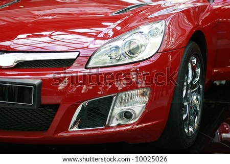 detail close up of a red sports car - stock photo