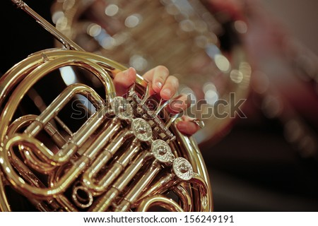 Detail close up of French Horn musical instrument, part of the Brass family of instruments - stock photo