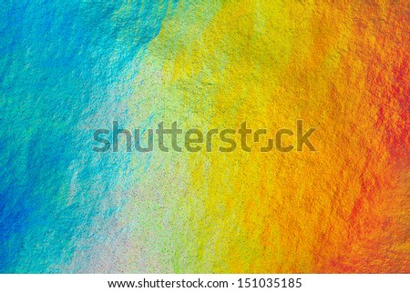 Detail close up of metallic paper in rainbow colors, as a colorful structured background image - stock photo