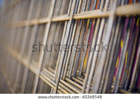 Detail close up of Steel Mesh used in construction industry for reinforcing concrete(deliberate very shallow depth of field) - stock photo