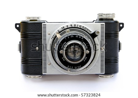 Detail Closeup of a 1930's Vintage Art Deco style camera , showing the mechanical shutter lever , and additional lever for setting the aperture. - stock photo
