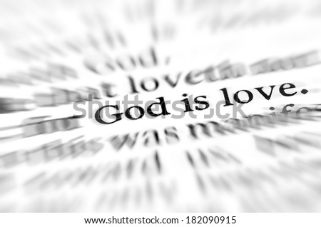 Detail closeup zoom God is love scripture in bible verse - stock photo