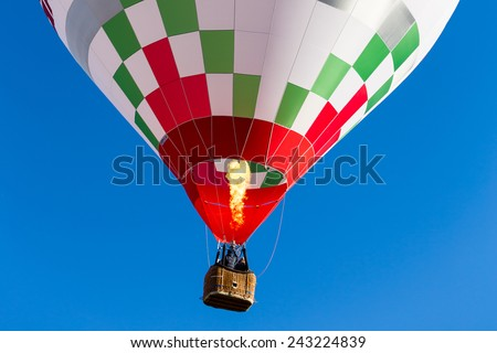 detail colorful hot air balloon in flight flame propane - stock photo