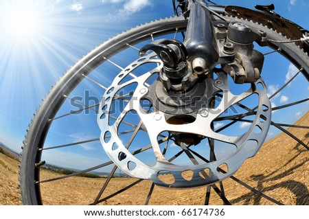 detail disc brakes on mountain bike - stock photo