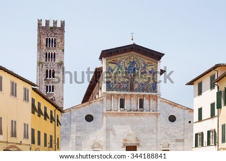 Detail exterior view of Lucca Cathedral (Duomo di Lucca, Cattedrale di San Martino) is a Roman Catholic cathedral dedicated to Saint Martin in Lucca, Italy. It is the seat of the Archbishop of Lucca.  - stock photo