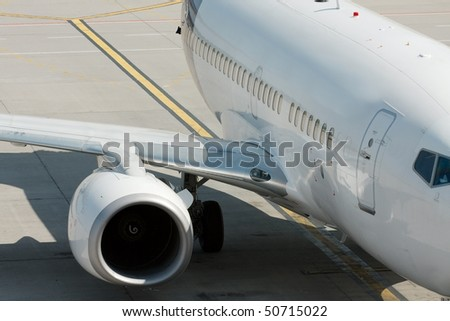 Detail f a parked plane on an airport - stock photo