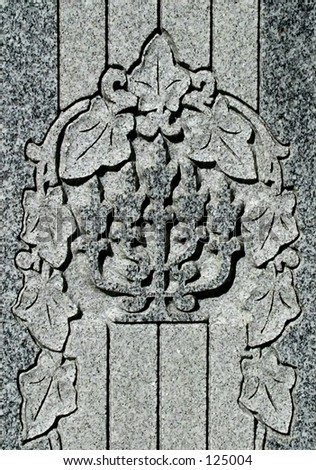 detail from gravestone in Jewish cemetary, showing a menorah - stock photo