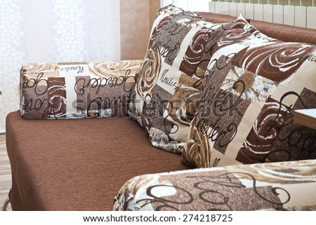 Detail from home sofa with pillows in beige brown tones - stock photo