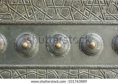 Detail from one of the bronze doors of the 395 year old Blue Mosque in Istanbul, Turkey - stock photo