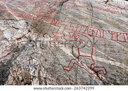 "Detail from one of the most famous rock carvings from the viking era in Scandinavia, the so called ""Sigurd carving"" nearby lake Malaren in Sweden.  - stock photo"
