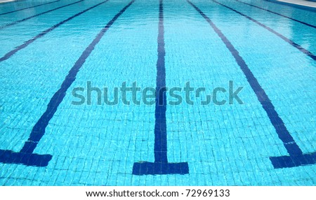 Detail from open air olympic swimming pool, water and lines - stock photo