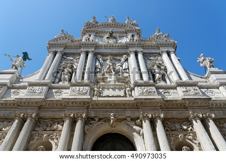 Detail from the elaborate facade of the ancient church of Santa Maria del Giglio, founded in the IX century in Venice, Italy
