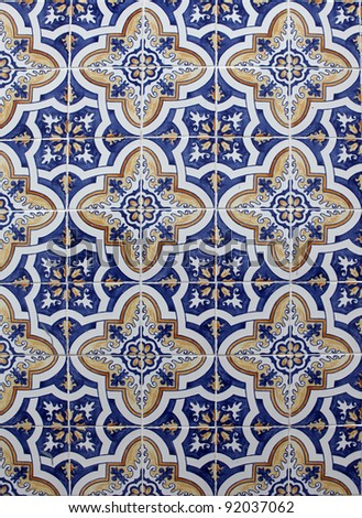 Detail from traditional tiles on facade of old house in Lisbon, Portugal - stock photo