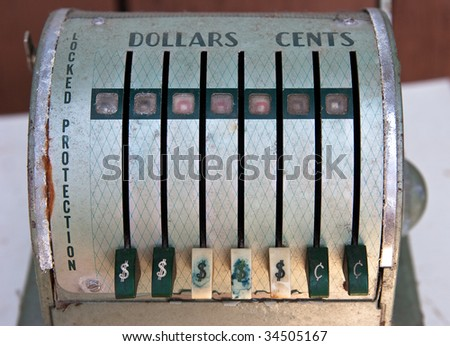 Detail front view of antique Paymaster cash register - stock photo