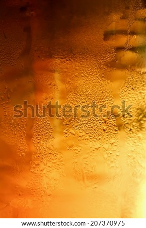 Detail glass of beer with bubbles - stock photo