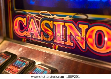 detail image of slot machine displaying the word casino. - stock photo