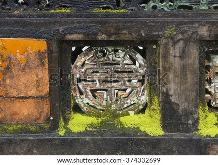 Detail in a wall at the Tomb of Minh Mang, Vietnam, showing the Chinese symbol of good luck, the Four Blessings - stock photo