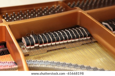 Detail inside the body of a white lacquered grand piano - stock photo