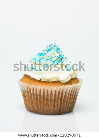 detail muffin with candy ornaments on white background - stock photo
