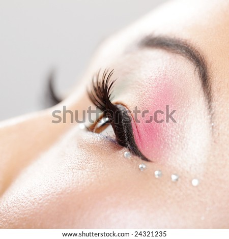 Detail of a beautifully made up female eye - stock photo