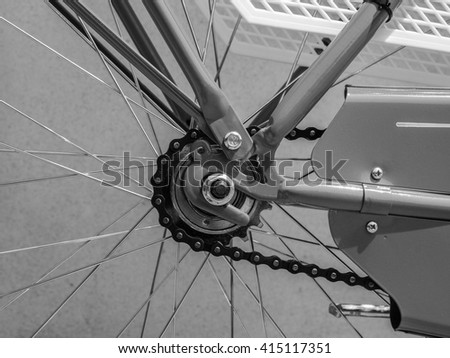 Detail of a bicycle roller chain in black and white
